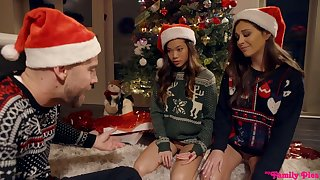 Two mouth watering girls are fucked hard by one dude under the Xmas three