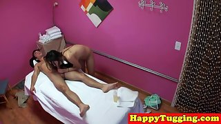 Asian masseuse tugging and sucking her client