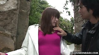 Japanese chick Sayo Hayakawa is tied up and finger fucked by two kinky dudes